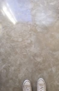 polished concrete floor cream style